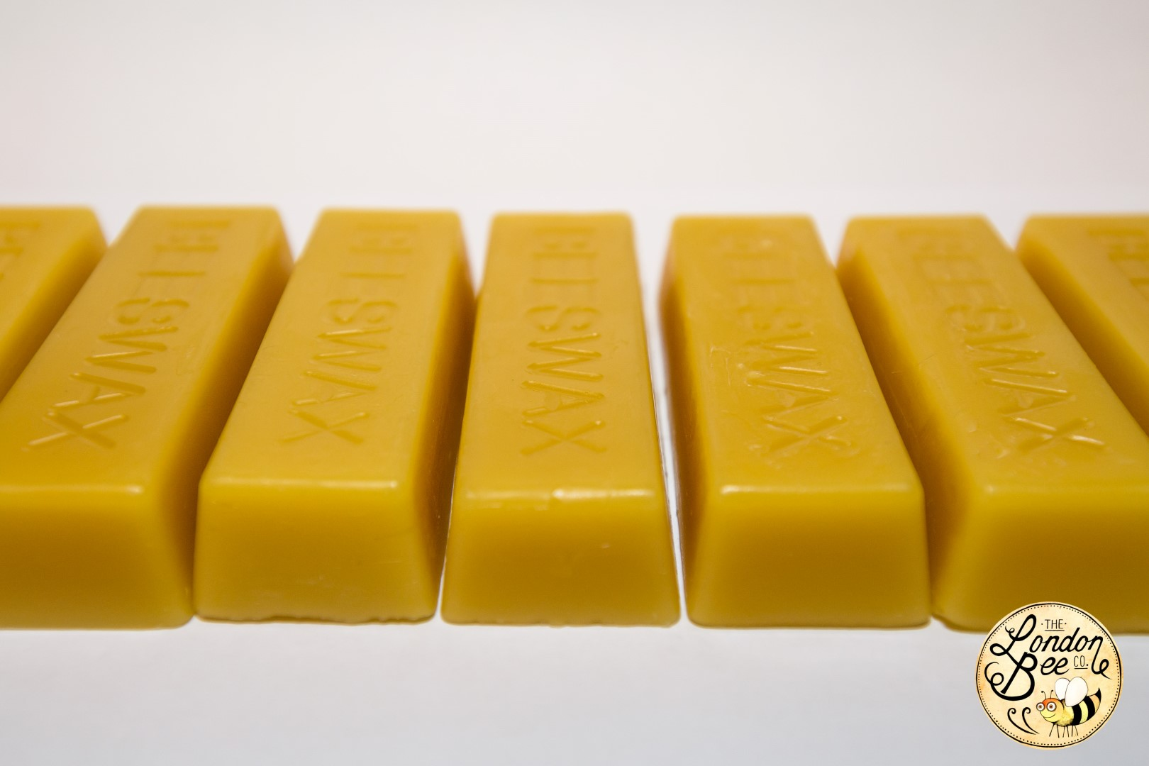 30g Beeswax Ingots The London Bee Company. Full resolution  portraiture, nominally Width 1620 Height 1080 pixels, portraiture with #824900.