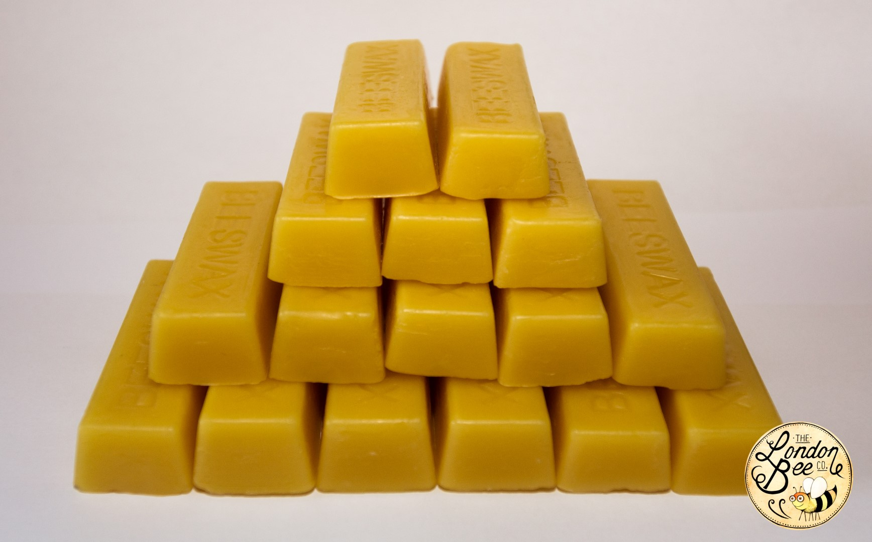 454g (1lb) Beeswax In Blocks The London Bee Company. Full resolution  portraiture, nominally Width 1736 Height 1080 pixels, portraiture with #793D01.